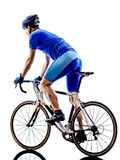 Cyclist cycling road bicycle rear view silhouette Stock Photo
