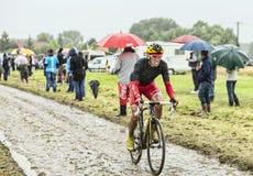 The Cyclist Daniel Navarro Garcia on a Cobbled Road - Tour de Fr Royalty Free Stock Photography