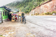 Cyclist on the dirt roa in the mountains of Guatemala. Royalty Free Stock Images