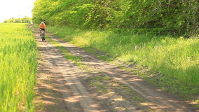 A cyclist on a dirt road stock video footage