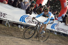 Cyclist on dirt track. Male cyclist on the track at the Cyclo Cross World Championship Royalty Free Stock Photos