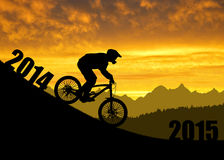Cyclist on downhill bike. Forward to the New Year 2015 Stock Photography