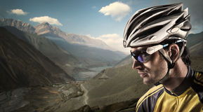Cyclist. Dramatic close-up portrait in the mountains royalty free stock image