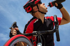 Cyclist drinking from a bottle Royalty Free Stock Images