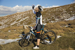 Cyclist drinking water. Stock Photography
