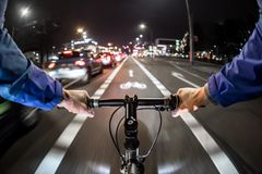 Cyclist drives on the bike path past the traffic jam. First-person view Royalty Free Stock Photo