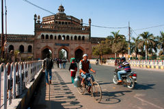 Cyclist drives past the famouse gateway in India Royalty Free Stock Images