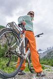 Cyclist enjoying a mountain view Stock Images