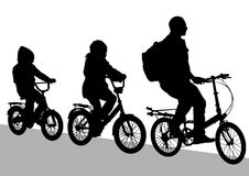 Cyclist family Stock Images