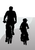 Cyclist father and son Stock Photo