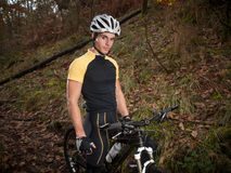 Cyclist in the forest Stock Photography