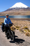 Cyclist in front of Parinacota volcano Stock Images