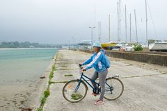 Cyclist girl on the pier. Royalty Free Stock Images
