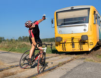 Cyclist has trouble on the railway crossing Royalty Free Stock Photos