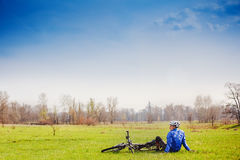 Cyclist have a rest with bike Stock Images