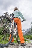 Cyclist having a rest on her trip Stock Image