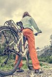 Cyclist having a rest on her trip Stock Images