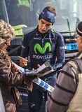The Cyclist Herada Signing Autograph to Fans. Houilles,France- March 3rd, 2013: The Spanish cyclist Jesús Herrada from Movistar team signs autograph to fans few Stock Photos