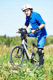 Cyclist with his bicycle bike on meadow Stock Images