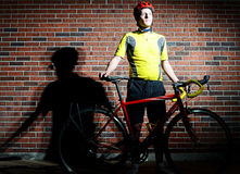 Cyclist and his bike. Bold image of a cyclist with his bike Royalty Free Stock Images