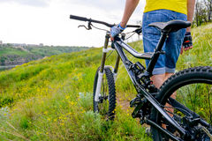 Cyclist and his Bike on Beautiful Spring Mountain Trail Royalty Free Stock Photos