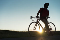 Cyclist beside his road bike Royalty Free Stock Photo