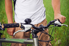 Cyclist holds handlebar of bicycle Royalty Free Stock Photography