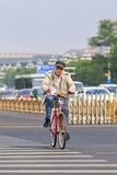 Cyclist on jammed Chang An Avenue, Beijing, China Stock Images