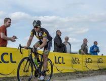 The Cyclist Jay Robert Thomson - Paris Roubaix 2015. Carrefour de l`Arbre, France - April 12,2015: The South African cyclist, Jay Robert Thomson of MTN-Qhubeka Royalty Free Stock Photo