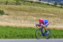 The Cyclist Jose Rodolfo Serpa Perez. Chorges, France- July 17, 2013: The Colombian cyclist Jose Serpa from Lampre-Merida Team pedaling during the stage 17 of Royalty Free Stock Images