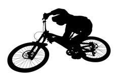 Cyclist jump downhill. Mountain biking black silhouette Royalty Free Stock Image