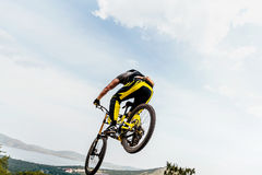 Cyclist jump mountain biking Stock Image