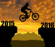Cyclist jumping into the New Year 2016. Silhouette cyclist jumping into the New Year 2016 Stock Photo