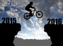 Cyclist jumping into the New Year 2016 Stock Image