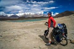 Cyclist at Kara Kul lake Royalty Free Stock Image