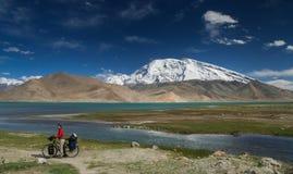 Cyclist at Kara Kul lake Royalty Free Stock Images