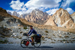 Cyclist on Karakorum Highway Stock Photo