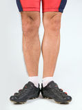 Cyclist legs Stock Images
