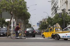 Cyclist in Lima traffic in Peru. LIMA, PERU - AUG 29TH 2015: The chaos of traffic in the city of Lima, affecting cyclists, pedestrians and vehicles. Lima Peru stock images