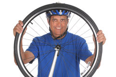 Cyclist looking thru Wheel Royalty Free Stock Image