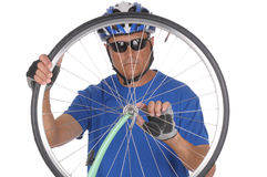 Cyclist looking through wheel Stock Photography