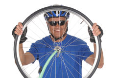 Cyclist looking through wheel Royalty Free Stock Images