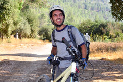 Cyclist man. Is standing with his bike, Jerusalem mountains Royalty Free Stock Photos