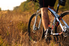 Cyclist man legs riding mountain bike on outdoor trail Royalty Free Stock Photography
