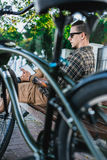 Cyclist Man Resting On Bench Near Bicycle And Using Tablet Communication Connection Digital Devices Technology Concept. Handsome young guy in sunglasses resting Stock Images