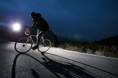 Cyclist man riding fixed gear sport bike. On a mountain road. Nocturne image Royalty Free Stock Image