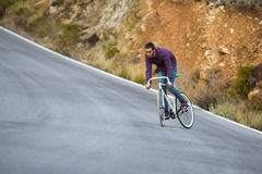 Cyclist man riding fixed gear sport bike in sunny day Stock Image