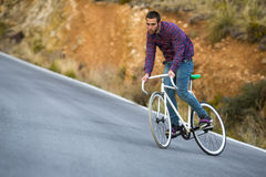 Cyclist man riding fixed gear sport bike in sunny day Royalty Free Stock Images