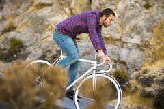 Cyclist man riding fixed gear sport bike in sunny day Royalty Free Stock Image