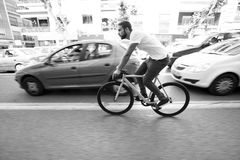 Cyclist man riding fixed gear sport bike. In sunny day on a city Royalty Free Stock Photo